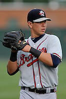 Left fielder Joey Meneses (34) of the Rome Braves before a game against the Greenville Drive on Tuesday, August 20, 2013, at Fluor Field at the West End in Greenville, South Carolina. Rome won, 4-2. (Tom Priddy/Four Seam Images)