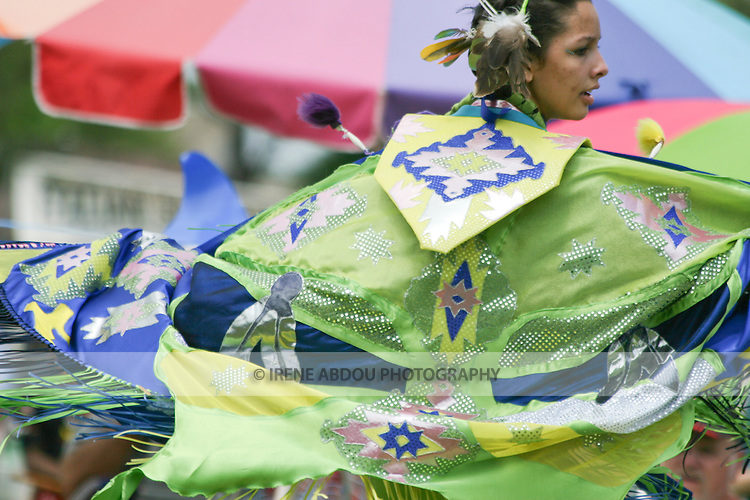 """A Native American dancer performs a """"Fancy Dance"""" at the 8th Annual Red Wing PowWow in Virginia Beach, Virginia."""