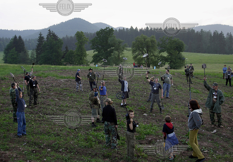 Contest in finding metal by metal detectors. Treasure hunters, collectors of old military equipment during their annual meeting in Gory Sowie , south-west Poland, 2007....(Photo by Piotr Malecki)