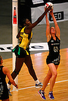 17.1.2014 New Zealand's Katrina Grant competes for ball with Jamaica's Jhaniele Fowler during their netball test match in London, England. Mandatory Photo Credit (Pic: Tim Hales). ©Michael Bradley Photography.