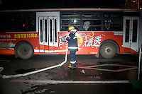 A firefighter rolls up a hose after responding to an alarm on the night of Lunar New Year celebrations in Nanjing, Jiangsu, China. Lunar New Year is also known as Chinese New Year.  2009 is the Year of the Ox, the Year of the Cow, or the Year of the Bull, according to the Chinese zodiac.  Niu is the Mandarin word for ox/cow/bull.
