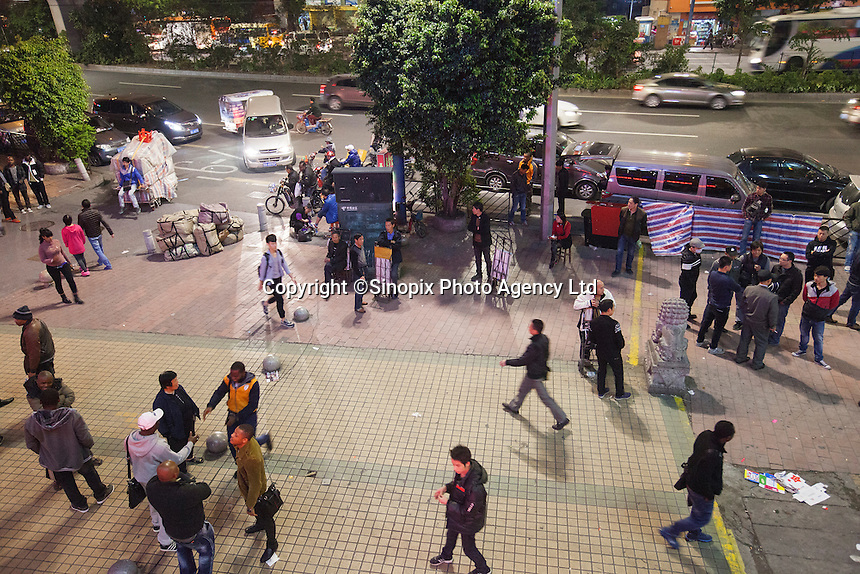 An aerial view of African and Chinese people in an area of Guangzhou known to locals as 'Chocolate City', Guangzhou, Guangdong Province, China, 08 December 2014. The health authorities of Guangzhou are said to be stepping up their monitoring of the African community in light of the ongoing outbreak of the Ebola virus disease in West Africa.