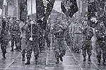 A large group of uniformed nationalists all standing to attention at the controversial Yasukini Shrine in Tokyo. Due to the enshrinement of 14 Class-A war criminals, the shrine is a magnet for the country's numerous right-wing groups, and this is especially the case on the day the photo was taken, National Foundation Day.
