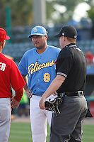 Myrtle Beach Pelicans manager Mark Johnson (8) meeting at home plate before a game against the Potomac Nationals at Ticketreturn.com Field at Pelicans Ballpark on May 22, 2015 in Myrtle Beach, South Carolina. Myrtle Beach defeated Potomac 8-4. (Robert Gurganus/Four Seam Images)