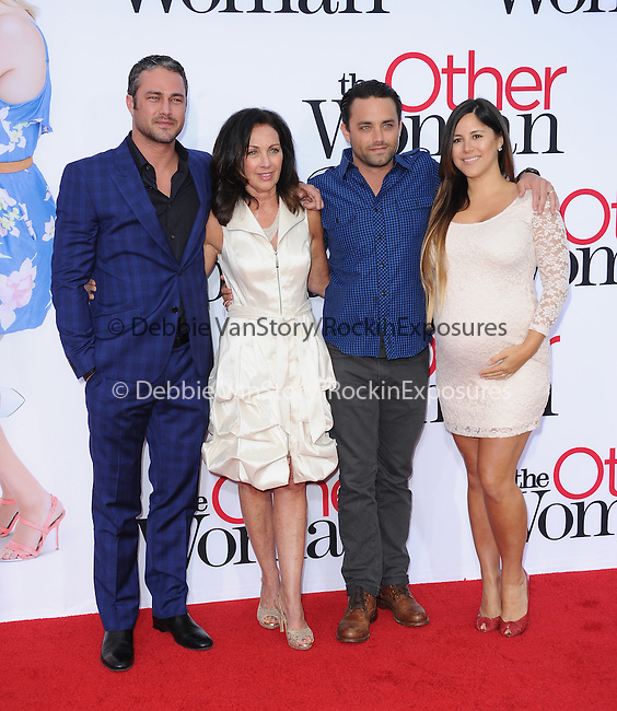 Taylor Kinney poses with his mom,brother and sister in law attends The Twentieth Century Fox L.A. Premiere of Th eOther Woman held at The Regency Village Westwood in Westwood, California on April 21,2014                                                                               © 2014 Hollywood Press Agency