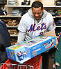 Dominic Smith, New York Mets rookie first baseman, loads a toy into a shopping cart during the team's Holiday Shopping Spree at Target in Elmhurst, NY on Wednesday, Nov. 29, 2017.