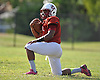 Clarke High School running back Aaron Dawson stretches during the start of varsity football practice at the school on Wednesday, September 23, 2015. The senior excels both on the gridiron and as a drummer in the school's marching band.<br /> <br /> James Escher