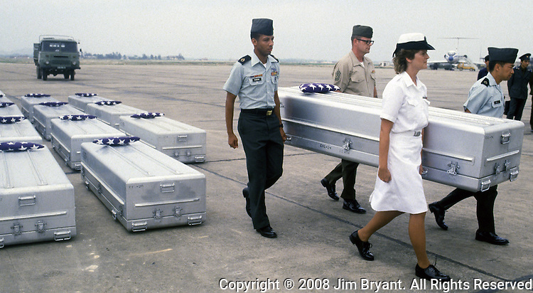 Coffins containing the remains of American MIA's are rendered honors by members of the U.S. Armed Forces  at Noi Bai Airport 15 miles from Hanoi, North Vietnam.  (Jim Bryant Photo).....