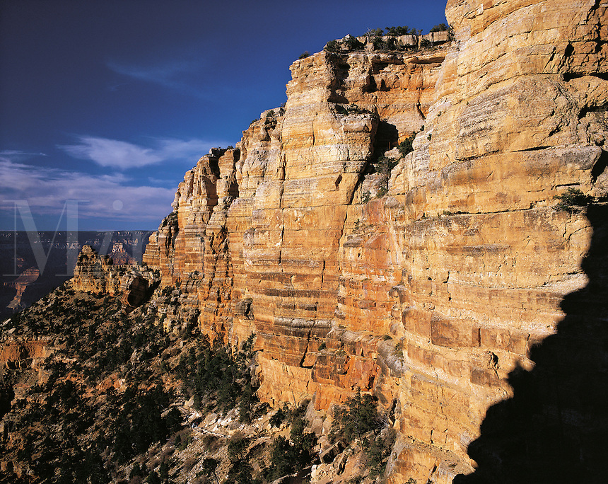 Tall cliffs below the South Rim of Grand Canyon, in dramatic evening light, Arizona, USA