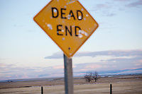 "A sign reads ""dead end"" next to a road north of Simms, Montana, USA."