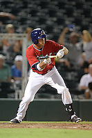 Fort Myers Miracle outfielder Chad Christensen (12) squares to bunt during a game against the Tampa Yankees on April 15, 2015 at Hammond Stadium in Fort Myers, Florida.  Tampa defeated Fort Myers 3-1 in eleven innings.  (Mike Janes/Four Seam Images)