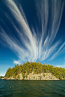 White pine trees (Pinus storbi) and mare's tail clouds on Crow (Kakagi) Lake<br /> Near Nestor Falls<br /> Ontario<br /> Canada