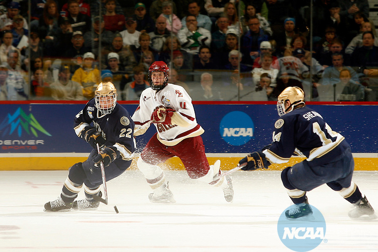 12 APR 2008:  Calle Ridderwall (22) of Notre Dame and Mike Brennan (4) of Boston College race after the puck during the Division I Men's Ice Hockey Championship held at the Pepsi Center in Denver, CO.  Boston College defeated Notre Dame 4-1 for the national title.  Jamie Schwaberow/NCAA Photos