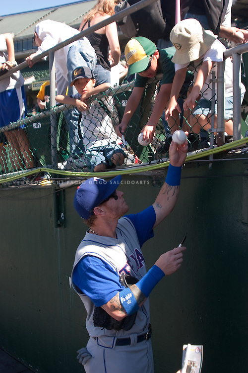 Paolo (Paul) Diego Salcido Baseball sports star Josh Hamilton at MLB game in Oakland signing baseballs fans
