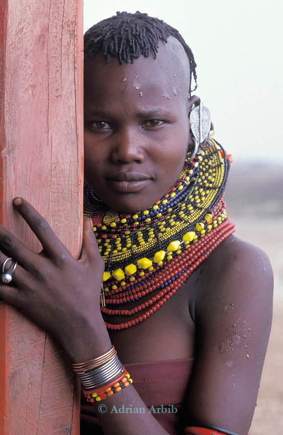 A Turkana  girl waiting  at a  famine relief station . Turkana region, Northern Kenya