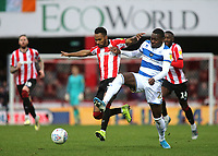 Rico Henry of Brentford tries to shake off a challenge from QPR's Bright Osayi-Samuel during Brentford vs Queens Park Rangers, Sky Bet EFL Championship Football at Griffin Park on 11th January 2020