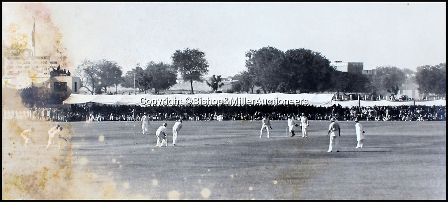 BNPS.co.uk (01202 558833)<br /> Pic: Bishop&MillerAuctioneers/BNPS<br /> <br /> Douglas Jardine and Bryan Valentine in their sixth wicket stand for the M.C.C.<br /> <br /> A fascinating album of photographs showing the first England cricket tour of India and the last for controversial 'Bodyline' captain Douglas Jardine has been discovered.<br /> <br /> The rare black and white images show the England star leading the national side at the new cricket ground in Delhi that the colonial British had built in 1933 - the same year as the brutal Ashes series.<br /> <br /> Jardine is featured in many photos as is the Viceroy of India. The album is being sold by auctioneers Bishop and Miller of Suffolk.