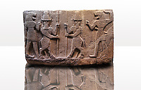 Picture of Neo-Hittite orthostat describing the legend of Gilgamesh from Karkamis,, Turkey. Museum of Anatolian Civilisations, Ankara. Mythological scene. The 2 figures in the center are flanked by lion headed men who have one fist outstretched and are known as Ugallu. The 2 figures in the middle holding spears are men with bodies of bulls known as Kusarikku. 3