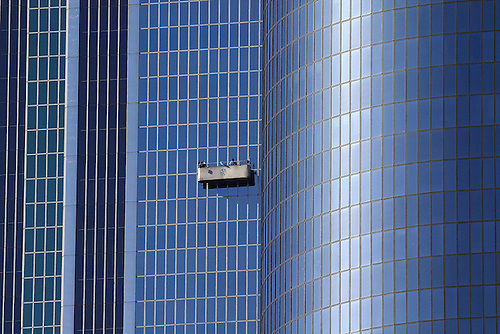 WINDOW WASHERS CAREFULLY PLY THEIR TRADE ON A LOS ANGELES SKYSCRAPER
