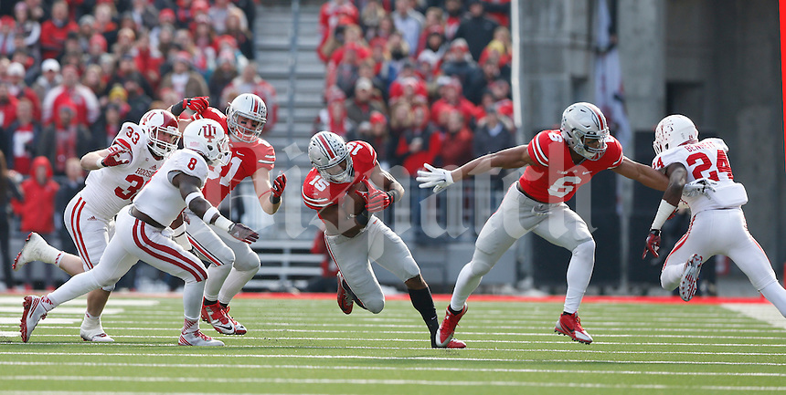 Ohio State Buckeyes running back Ezekiel Elliott (15) with help from Ohio State Buckeyes wide receiver Evan Spencer (6) heads upfield in the third quarter at Ohio Stadium Nov. 22, 2014.(Dispatch photo by Eric Albrecht)