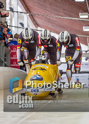 9 January 2016: Germany pilot Nico Walther leads his 4-man team as they push off their first start of the day at the BMW IBSF World Cup Bobsled Championships at the Olympic Sports Track in Lake Placid, New York, USA. Walther's team ended the day in 13th place with a 2-run combined time of 1:51.23. Mandatory Credit: Ed Wolfstein Photo *** RAW (NEF) Image File Available ***