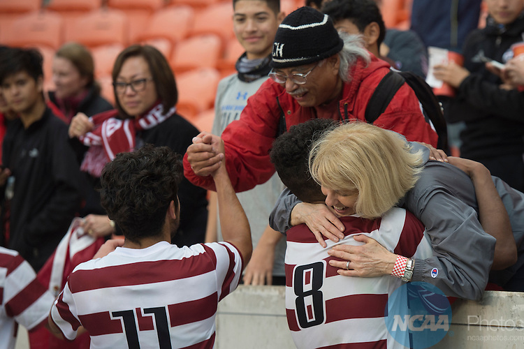 1HOUSTON, TX - DECEMBER 11:  Brian Nana-Sinkam of Stanford University embraces a fan after the Division I Men's Soccer Championship held at the BBVA Compass Stadium on December 11, 2016 in Houston, Texas.  Stanford defeated Wake Forest 1-0 in a penalty shootout for the national title. (Photo by Justin Tafoya/NCAA Photos via Getty Images)