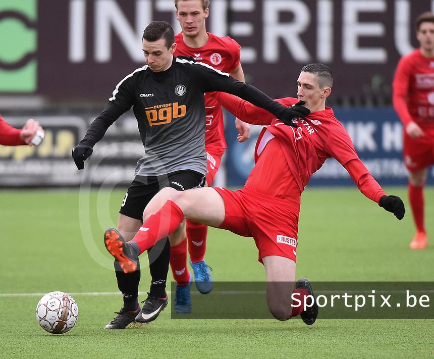 FC GULLEGEM - RC GENT :<br /> Lionel Vanleynseele (R) tracht Seppe De Langhe (L) af te stoppen met een tackle <br /> <br /> Foto VDB / Bart Vandenbroucke