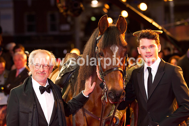 **ALL ROUND PICTURES FROM SOLARPIX.COM**                                             **NO UK NEWSPAPER PUBLICATION**.**UK MAGAZINE & SUPPLEMENT PUBLICATION ONLY** AND NO PUBLICATION IN AUSTRALIA, BELGIUM, FRANCE, GERMANY, ITALY, SCANDINAVIA AND USA**                                                                                   UK Premiere of WAR HORSE in Leicester Square, London..This pic:    Steven Spielberg and Jeremy Irvine                                                                                          JOB REF:    14341    SFE       DATE:   08.01.12                                                         **MUST CREDIT SOLARPIX.COM OR DOUBLE FEE WILL BE CHARGED**                                                                      **MUST AGREE FEE BEFORE ONLINE USAGE**                               **CALL US ON: +34 952 811 768 or LOW RATE FROM UK 0844 617 7637**