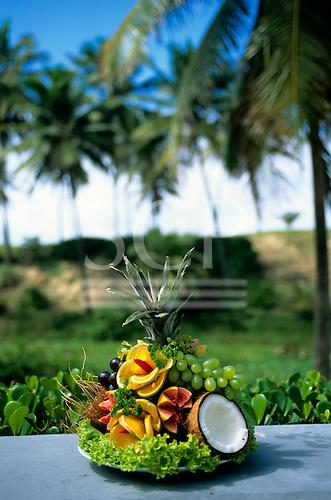 Sauipe, Brazil. Display of fresh fruits; pineapple, papaya, orange, guava, grapes, cocnut.