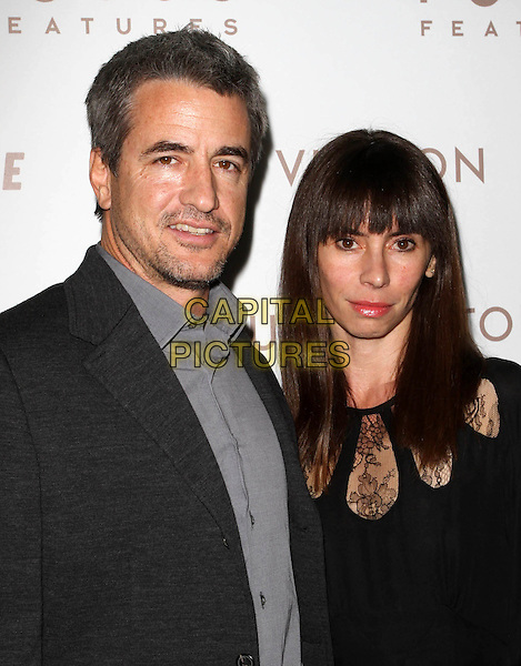 "DERMOT MULRONEY & THARITA CATULLE.Premiere of ""Somewhere"" held At The Arclight Theatres, Hollywood, CA, USA..December 7th, 2010.half length black dress suit couple grey gray pink stubble facial hair.CAP/ADM/KB.©Kevan Brooks/AdMedia/Capital Pictures."
