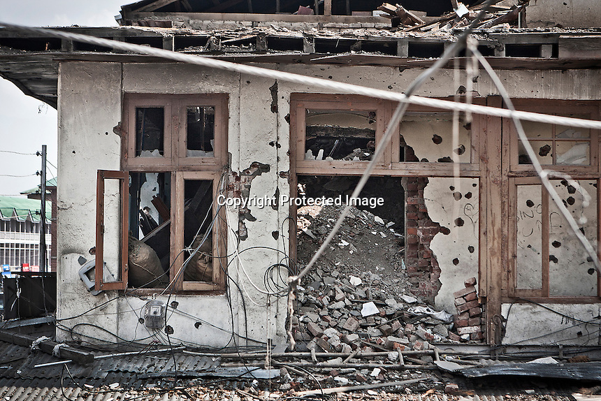 Ruins of a former hotel show the marks of a gun battle that took place in early 2010, between Mujahideen rebels and Indian troops, in the core of the commercial area in Srinagar. In spite of severe crackdowns imposed by Indian forces, Islamist armed militancy is still fighting along the Kashmir valley, but its number has shrunk steeply. Srinagar, Indian administrated Kashmir.