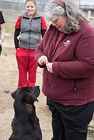 Dr. Christine Calder with students at West Point animal shelter.  Teaching behavior medicine.