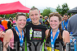Orla Stack, Nick Stack and Sinead Nolan killarney celebrate completing the Run Killarney Marathon on Saturday