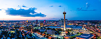 San Antonio Skyline at Twilight Pano2 -San Antonio skyline on prints, canvas and metal.<br /> Another San Antonio skyline at twilight with two of the city landmarks in view the Tower of America and the Tower Life building. Also in view is the new Henry B Gonzales convention center along with all the other cities buildings. San Antonio is for the first time starting to change it skyline with serveral new building schedule like the Frost Bank building which will be finished sometime next year. We thought this was a color view of the city with it most popular high rise buildings like the Drury, the Tower Life building, Grand Hyatt along with with many of the new buildings along with many on the way.