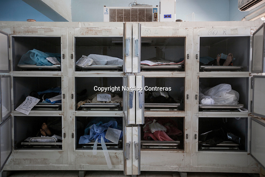 The corpses of illegal sub-Saharan migrants lie in the morgue of Sabha City, after having been collected from the streets and the desert during the previous days.
