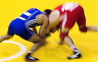 17 JUL 2010 - SHEFFIELD, GBR - Krasimir Krastanov (GBR) (blue) and Alexandru Chirtdeca (MDA) (red) clash during their GB Cup match .(PHOTO (C) NIGEL FARROW)