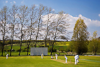 Locals play cricket, Swinbrook, The Cotswolds, United Kingdom