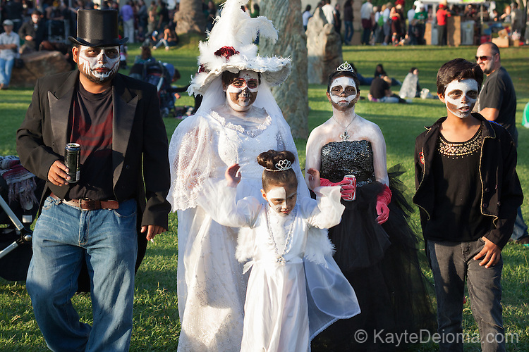 A family dressed up for Dia de Los Muertos celebration at Hollywood Forever Cemetery in Hollywood, CA