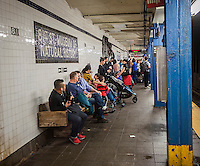Long suffering subway riders wait for a train at the 81st Street station station on the New York subway on Sunday, October 30, 2016. As is usually the case, maintenance work done on weekends disrupts the frequency and the routes of multiple subway lines. (© Richard B. Levine)
