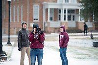 Snow Day on campus - students on sidewalk, taking photos.<br />  (photo by Megan Bean / &copy; Mississippi State University)