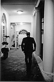 United States President Gerald R. Ford walks alone along the Colonnade towards the Residence from the Oval Office at the White House in Washington, D.C. on May 14, 1975.  <br /> Mandatory Credit: David Hume Kennerly / White House via CNP