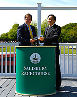 Connections of Rumble in the Jungle are presented with their trophy after winning The Penang Turf Club Malaysia Novice Stakes (Plus 10 Race) (Class 4) during Afternoon Racing at Salisbury Racecourse on 17th May 2018