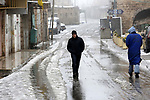 A Palestinian man walks on on a street during a winter storm, in the West Bank city of Hebron, on January 17, 2019. Photo by Wisam Hashlamoun