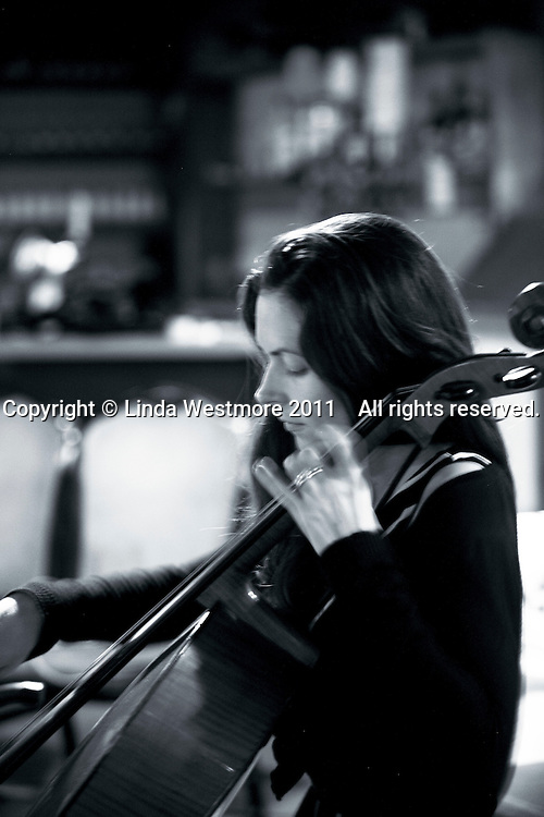 """Melanie Row, cellist with the """"Edge of Chaos Orchestra"""" recording at the Blue Coconut Club, Pulborough, West Sussex."""