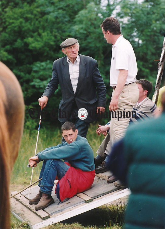 Taking it easy at the fair at Spancilhill - July 2, 1999. Photograph by John Kelly