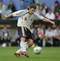 JUNE 9, 2006: Munich, Germany: German midfielder Torsten Frings (8) goes for a goal during the World Cup Finals in Munich, Germany.  Germany defeated Costa Rica, 4-2.