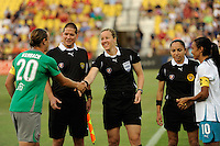 Referee Margaret Domka performs the coin toss during the Women's Professional Soccer (WPS) All-Star Game at KSU Stadium in Kennesaw, GA, on June 30, 2010.
