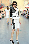 Pau walks runway in a Douglas Hannant Resort 2012 outfit, on the USS Intrepid, June 7, 2011.