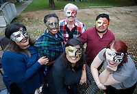 NWA Democrat-Gazette/DAVID GOTTSCHALK  Patricia Rodriguez (from left), Iesha Williams, Anne Shelley, the executive director, Natalia Gomez, Diego Barrera and Nikki Warren, with the Northwest Arkansas Center for Sexual Assault, pose with masks Monday, Novemeber 7, 2016, in anticipation of the Light Up the Night fundraiser taking place Saturday, November 19.