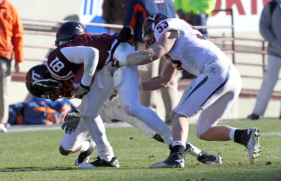 Nov 27, 2010; Charlottesville, VA, USA;  Virginia Tech Hokies wide receiver Jarrett Boykin (81)is tackled by Virginia Cavaliers linebacker Steve Greer (53) during the game at Lane Stadium. Virginia Tech won 37-7. Mandatory Credit: Andrew Shurtleff-